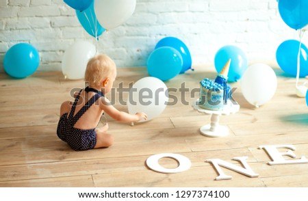 One year old boy is celebrating his first birthday among balloon Stock photo © Stasia04