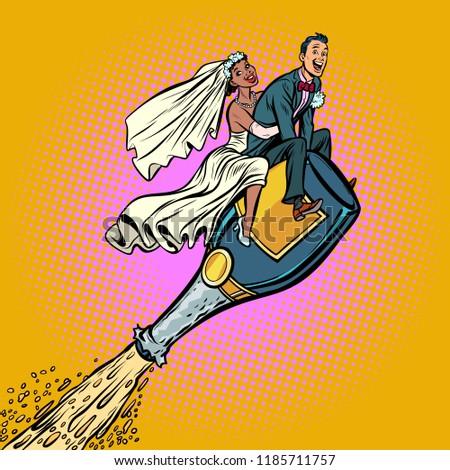 Bride and groom wedding. Inter-ethnic couple. Flying on a bottle Stock photo © rogistok