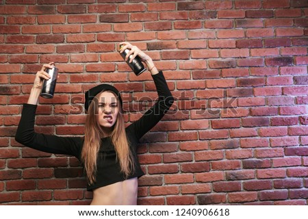 Image of stylish hip hop girl 20s, standing against brick wall w Stock photo © deandrobot