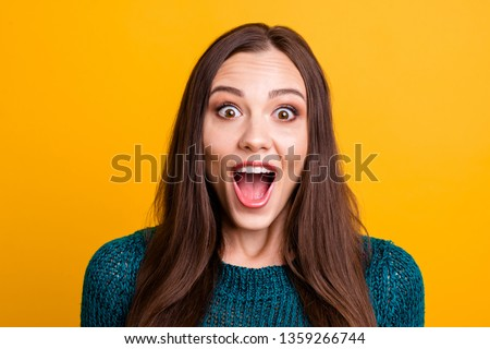 Brunette girl surprised looking with opened mouth at price of dress. Stock photo © studiolucky
