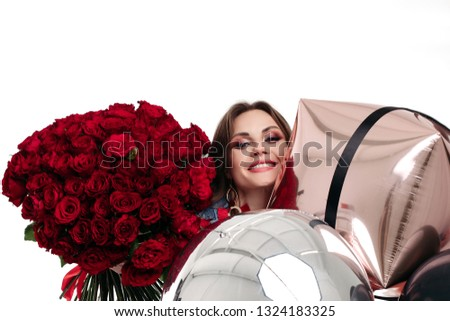 Pretty positive girl with make up holding bouquet of red roses and air balloons. Stock photo © studiolucky