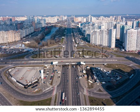 Panoramic aerial view from drone Pozniaky district, Mykoly Bazhana Ave with traffic and modern build Stock photo © artjazz