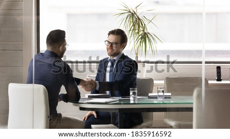 image of positive arabic businessman 30s in formal suit smiling stock photo © deandrobot