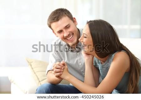 человека женщину сидят диван квартиру Сток-фото © deandrobot