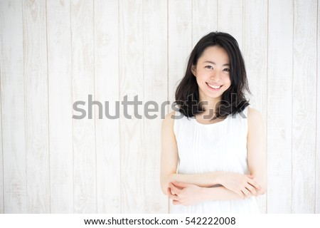 Portrait of a young smiling beautiful oriental woman with long dark hair. Lifestyle picture of a mod Stock photo © ElenaBatkova