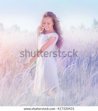 gekruld · meisje · permanente · lavendel · veld · witte · jurk · hoed - stockfoto © ElenaBatkova