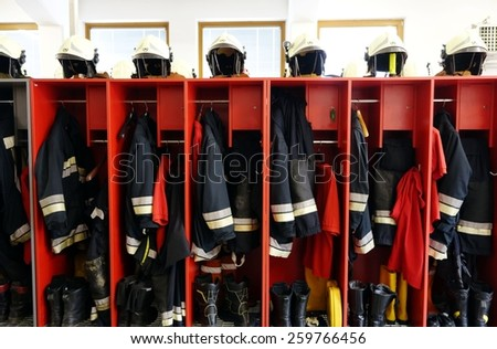 Close up of Fireman coats, helmets and boots wait for the next call. Dressing room of the volunteer  Stock photo © galitskaya