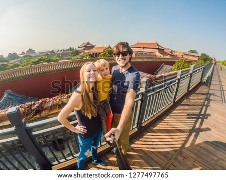 Enjoying vacation in China. Happy family with national chinese flag in Forbidden City. Travel to Chi Stock photo © galitskaya