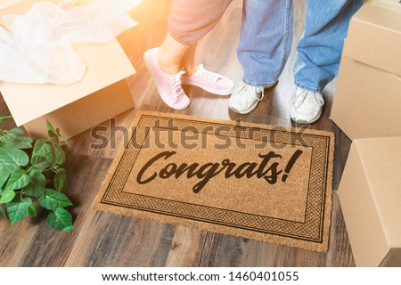 Man and Woman Unpacking Near Welcome Mat with Congrats, Moving B Stock photo © feverpitch