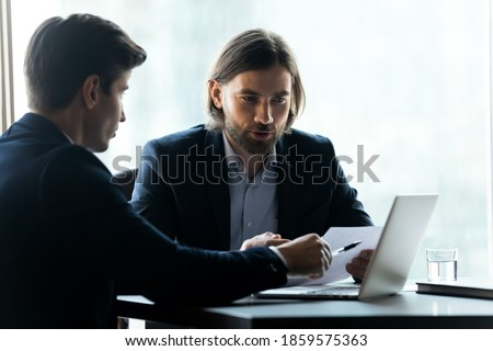 Executive businessman working analyzing investment using tablet  stock photo © Freedomz