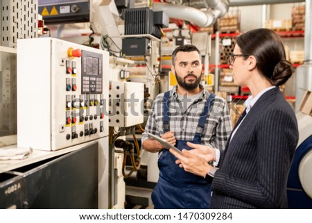 young worker consulting his partner about new methods of processing raw material stock photo © pressmaster