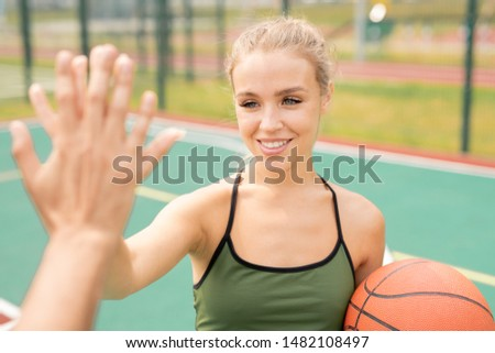 Happy girl with toothy smile making high-five gesture with her friend Stock photo © pressmaster