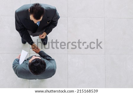 Meeting and greeting, Two executive businessman handshake after  stock photo © Freedomz