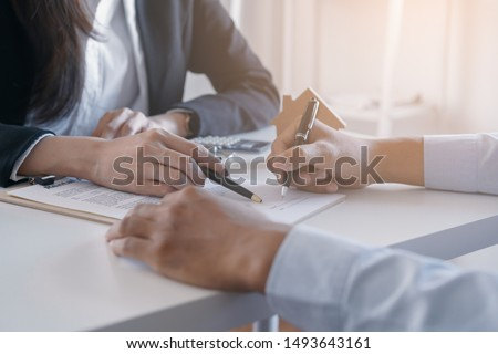 man signing contract of loan agreement document with bank broker stock photo © freedomz