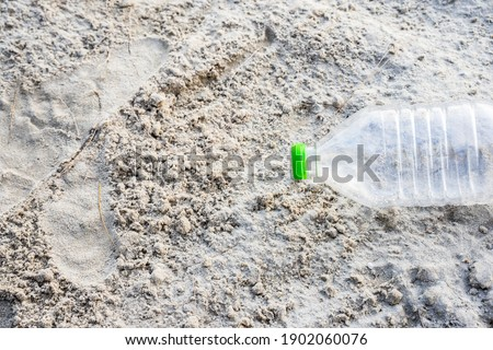 copy space of empty garbage bottles on sand beach texture background nature and environment concept stock photo © galitskaya