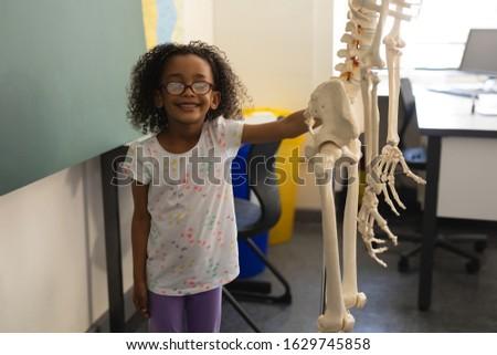 Elöl kilátás kicsi boldog fekete iskolás lány Stock fotó © wavebreak_media