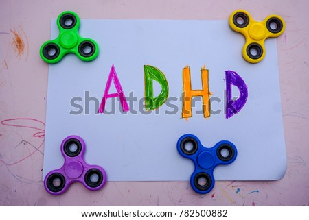 spinner helps with adhd syndrome adhd is attention deficit hyperactivity disorder close up stock photo © galitskaya