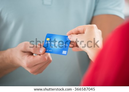 Hand of young female taking plastic card from man hand in the mall Stock photo © pressmaster