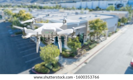 Unmanned Aircraft System Quadcopter Drone In The Air Near House Stock photo © feverpitch