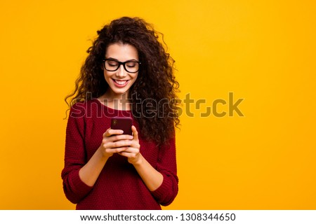 Pretty woman with curly hairstyle plays and enjoys with adorable small dog in bed, has good mood, po Stock photo © vkstudio
