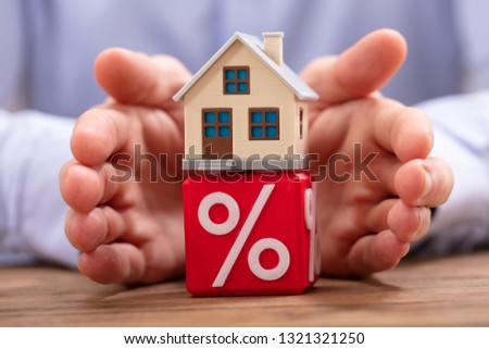 Person Protecting House Model Over Cube With Percentage Symbol Stock photo © AndreyPopov