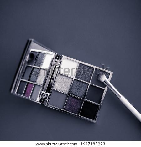 Eyeshadow palette and make-up brush on graphite background, eye  Stock photo © Anneleven