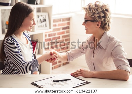 Female doctor shakes hands with girl child patient, talks supportive words, cares about kid during p Stock photo © vkstudio