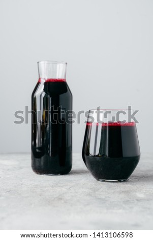 Vertical shot of fresh beetroot drink full of vitamins, in glass bottle, isolated over white backgro Stock photo © vkstudio