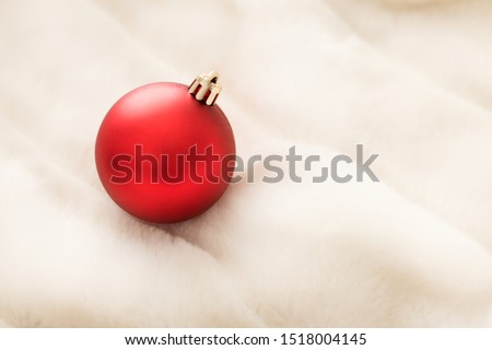 Red Christmas baubles on white fluffy fur backdrop, luxury winte Stock photo © Anneleven