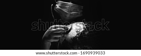 Hands of kid holding globe put stethoscope on sphere COVID-19 pa Stock photo © amok