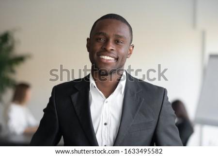 Portré vonzó jómódú üzletember fekete öltöny fehér Stock fotó © vkstudio