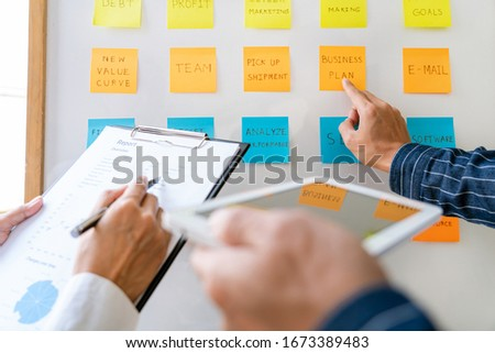 Business people arranging sticky notes commenting and brainstorm Stock photo © snowing