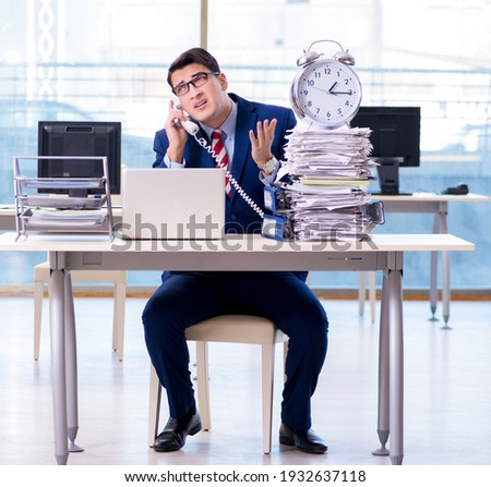 The businessman employee in urgency and deadline concept with alarm clock Stock photo © Elnur