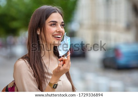 Woman Removing Face Mask Stock photo © AndreyPopov