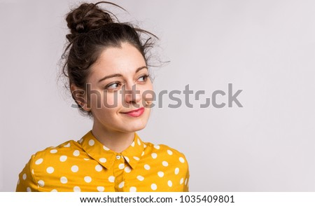 Close up portrait of attractive dark haired woman with brilliant smile, stands indoor against rosy b Stock photo © vkstudio