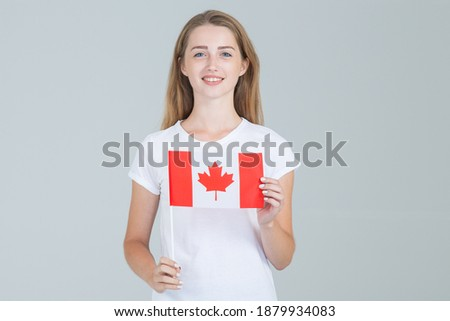 portrait of a pretty young woman against a canadian flag smili stock photo © hasloo