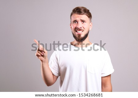 Portrait of one happy handsome young man and a lot of similar wo stock photo © HASLOO