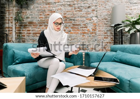 Closeup portrait of young pretty woman at her desk with deposit  Stock photo © HASLOO