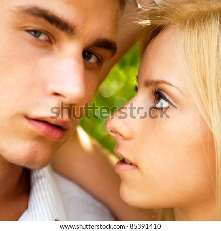 portrait of beautiful young couple standing against green tree i stock photo © hasloo