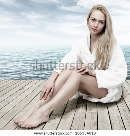 женщину халат сидят пляж портрет назад Сток-фото © photography33