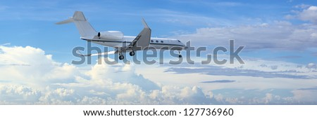 Private jet is maneuvering for landing in a cloudy sky. Panorami Stock photo © moses
