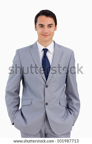 Good-looking man with hands in the pockets against white background stock photo © wavebreak_media