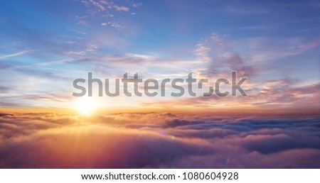 dramatic sunset view of sunset above clouds from airplane wind stock photo © ewastudio
