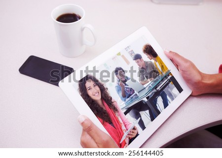 composite image of smiling casual young woman scrolling on her t stock photo © wavebreak_media