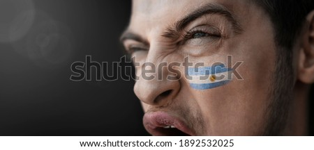 Portrait of an argentinian football fan with flag on his body and face, isolated on white Stock photo © deandrobot