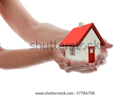 White house in hand for sale with red roof and chimney. Background sun shines brightly on right Stock photo © cherezoff