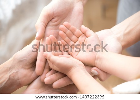 Connected hands of adults and child as symbol of unity of family. Thumb is lifted upwards! Stock photo © Paha_L