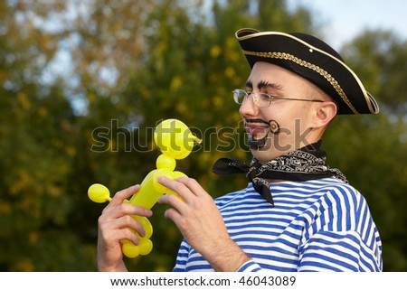 Smiling handsome man in pirate suit looking at doggy air-ballon. stock photo © Paha_L