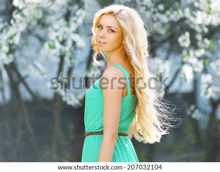 Tender natural young blonde woman with long hair smells flower  Stock photo © deandrobot