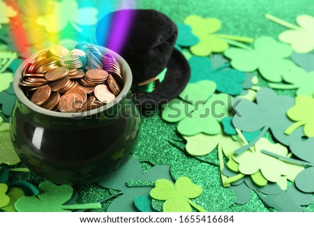 Pot of gold coins. Full cauldron of gold. Patrick green hat with gold buckle. Happy Patricks Day let Stock photo © orensila